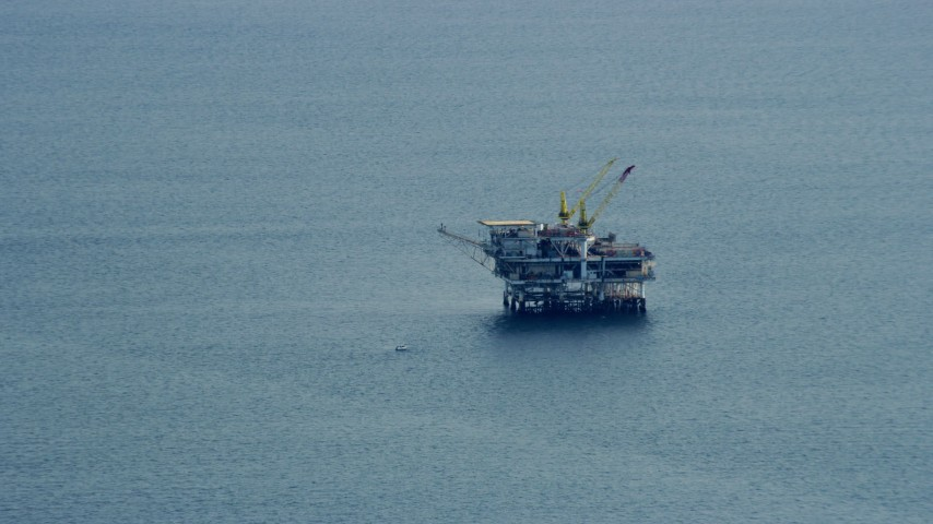 8K stock footage aerial video flying by an oceanic oil rig off the coast of Southern California Aerial Stock Footage | AX0160_034