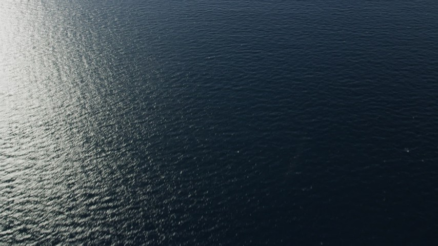 8K stock footage aerial video of a reverse view of the Pacific Ocean off the coast of Southern California Aerial Stock Footage | AX0160_035