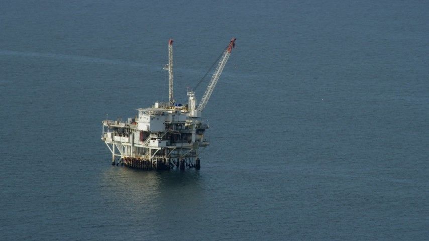8K stock footage aerial video of an oceanic oil derrick off the coast of Southern California Aerial Stock Footage   AX0160_037