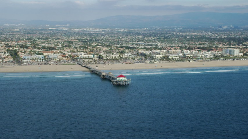 8K stock footage aerial video of an Huntington Beach Pier and beach in Huntington Beach, California Aerial Stock Footage | AX0160_039