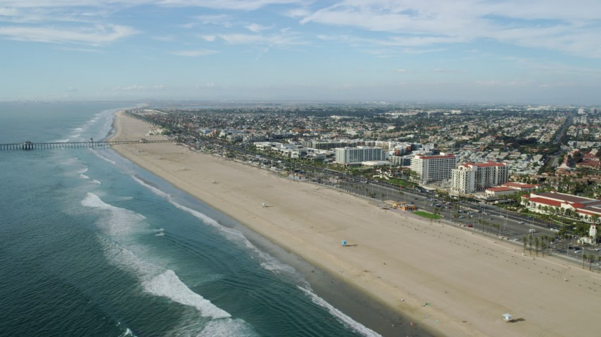 8K stock footage aerial video of Huntington Beach Pier and Hyatt Regency in Huntington Beach, California Aerial Stock Footage | AX0160_040