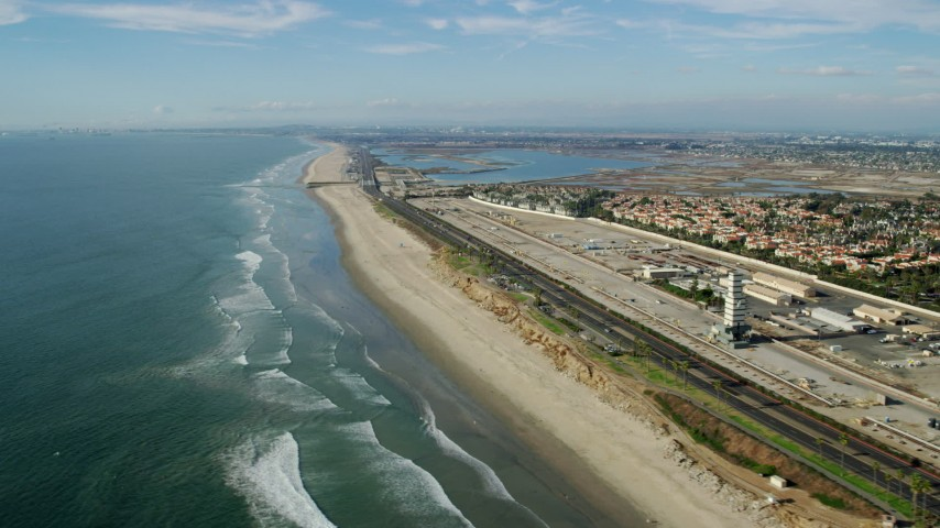 8K stock footage aerial video of Hwy 1 between an industrial area and the beach, Huntington Beach, California Aerial Stock Footage | AX0160_045