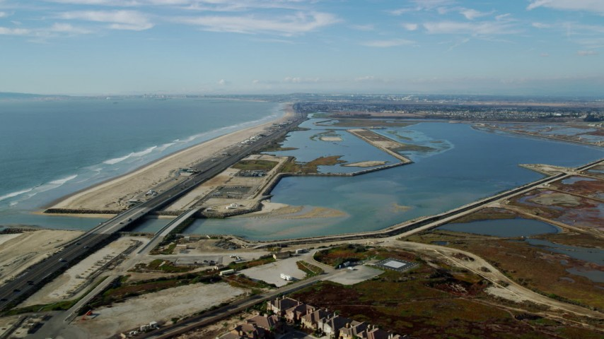 8K stock footage aerial video flying over Hwy 1 and beach to Bolsa Chica Basin State Marine Conservation Area, Huntington Beach, California Aerial Stock Footage | AX0160_046
