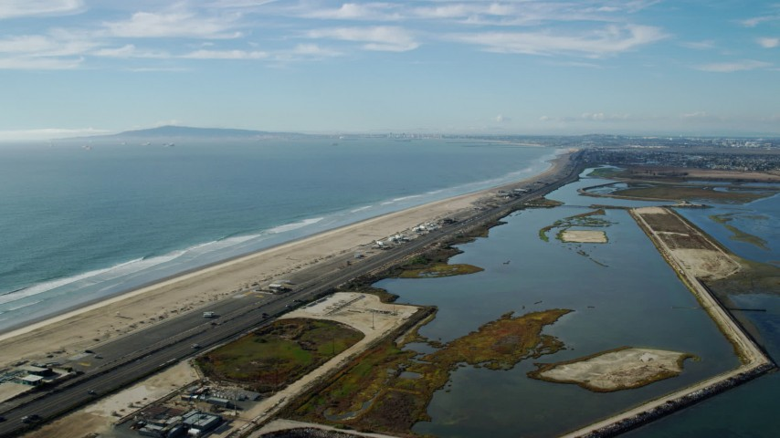 8K stock footage aerial video of Hwy 1 and Bolsa Chica Basin State Marine Conservation Area, Huntington Beach, California Aerial Stock Footage | AX0160_047