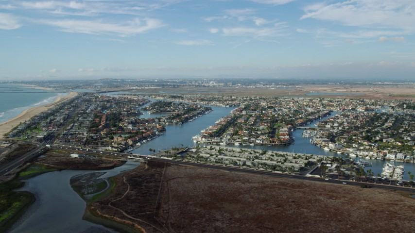 8K stock footage aerial video approaching the Huntington Harbour residential community in Huntington Beach, California Aerial Stock Footage | AX0160_050