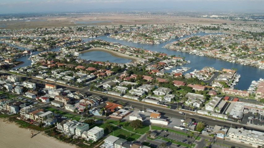 8K stock footage aerial video of homes in Huntington Harbour neighborhood of Huntington Beach, California Aerial Stock Footage | AX0160_051