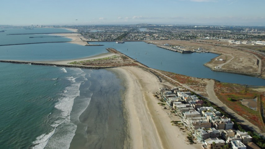8K stock footage aerial video following Hwy 1 and beach to approach Anaheim Bay, Seal Beach, California Aerial Stock Footage AX0160_053