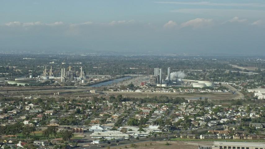 8K stock footage aerial video of LADWP Haynes Generating Station behind residential neighborhoods in Long Beach, California Aerial Stock Footage | AX0160_054