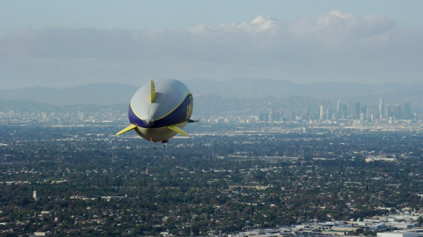 8K aerial video of the Goodyear Blimp flying toward Downtown Los Angeles from Long Beach, California Aerial Stock Footage | AX0160_063