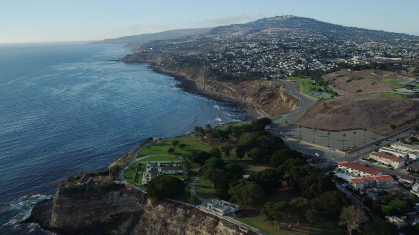 8K stock footage aerial video of Point Fermin Lighthouse and homes atop coastal cliffs in San Pedro, California Aerial Stock Footage | AX0161_016