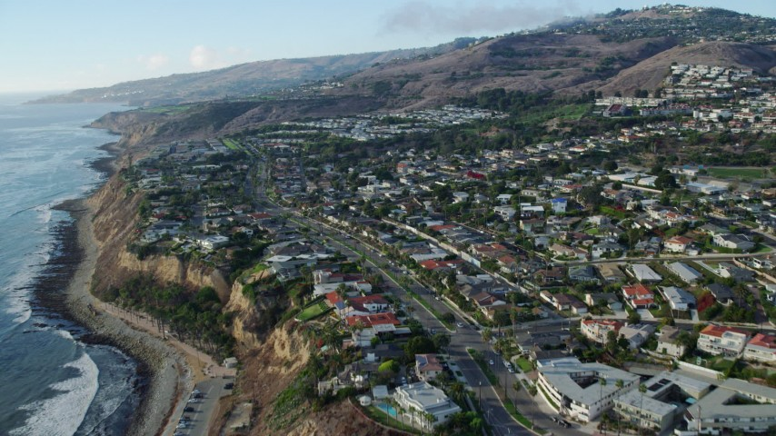 8K stock footage aerial video approaching and flying over homes near coastal cliffs in San Pedro, California Aerial Stock Footage | AX0161_019