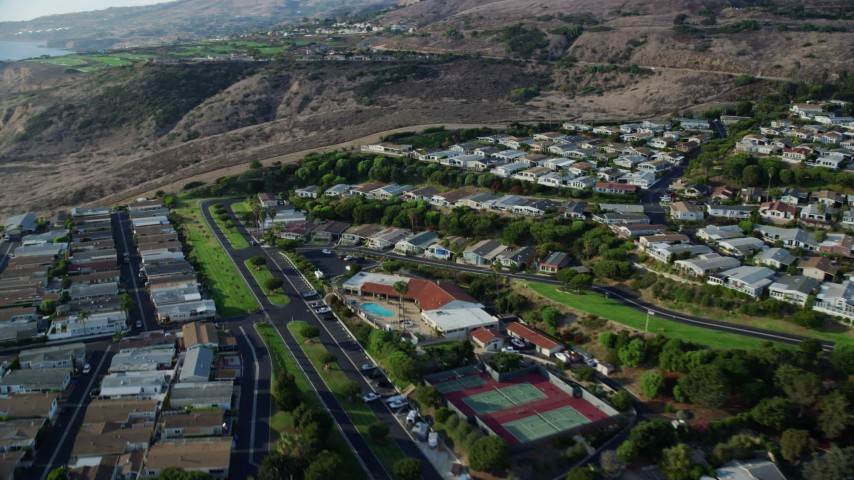 8K stock footage aerial video passing hillside homes in San Pedro, California Aerial Stock Footage   AX0161_020
