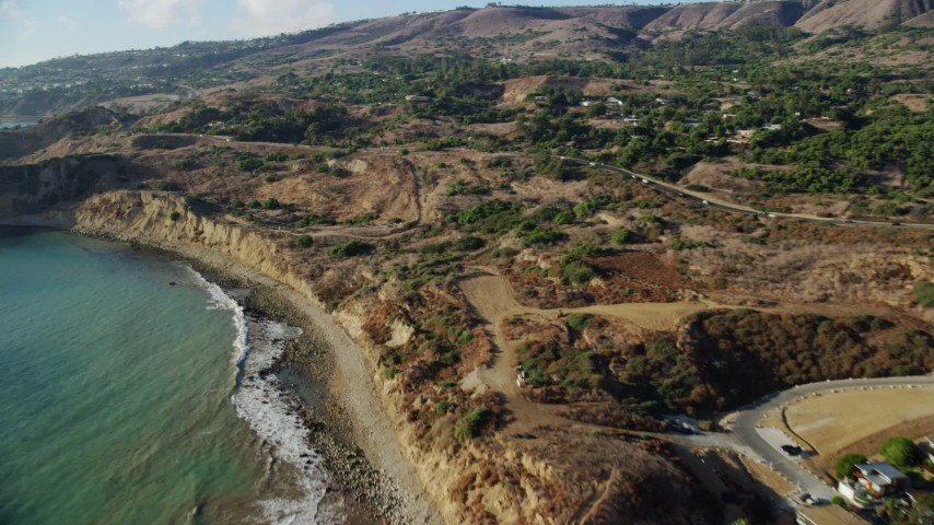 8K aerial video flying over beach to approach Palos Verdes Drive, Rancho Palos Verdes, California Aerial Stock Footage | AX0161_023