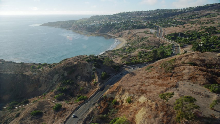 8K aerial video flying over Palos Verdes Drive and cliffs to Abalone Cove, Rancho Palos Verdes, California Aerial Stock Footage | AX0161_024