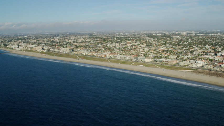 8K stock footage aerial video approaching Torrance Beach in the seaside city of Redondo Beach, California Aerial Stock Footage   AX0161_034