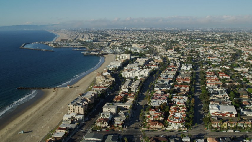 8K stock footage aerial video flying over Torrance Beach and pan across Redondo Beach, California to reveal King Harbor Marina Aerial Stock Footage   AX0161_035