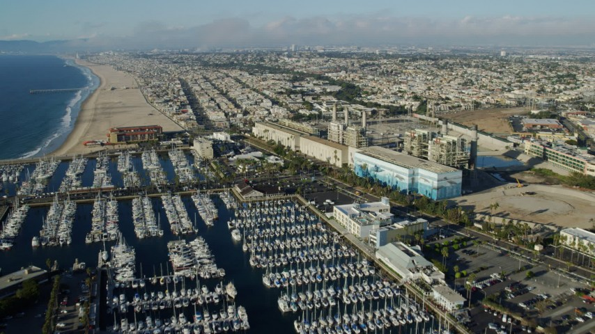 8K stock footage aerial video flying over marina and power plant in Redondo Beach, California to approach Hermosa Beach Pier Aerial Stock Footage | AX0161_037