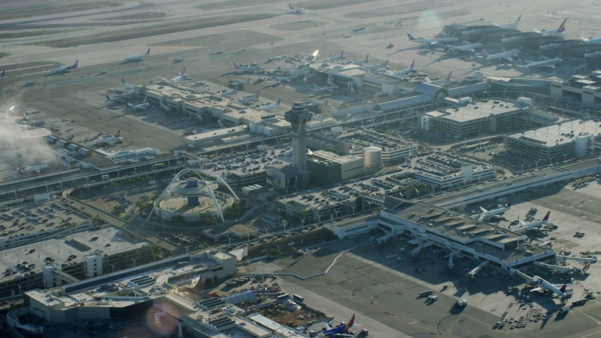 8K stock footage aerial video of a reverse view of the control tower and terminals at LAX, California Aerial Stock Footage | AX0161_048
