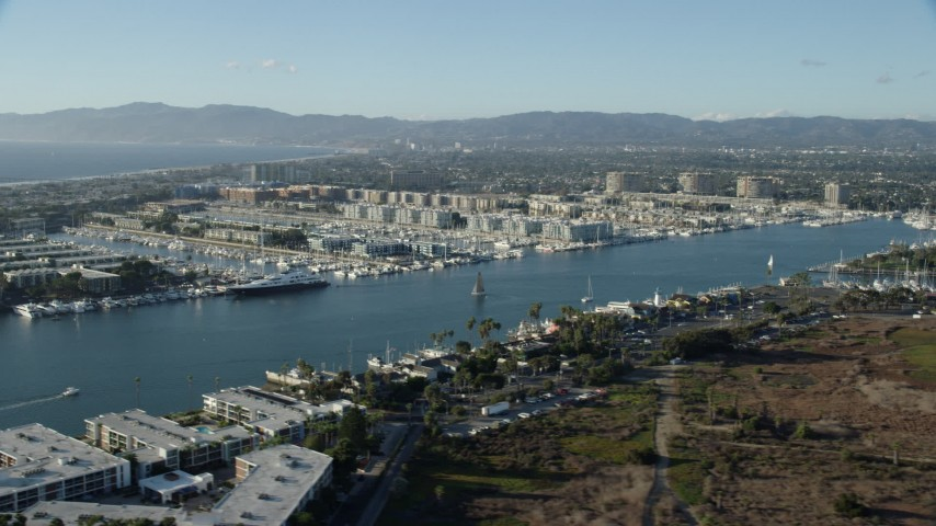 8K stock footage aerial video of waterfront apartment buildings and marinas in Marina Del Rey, California Aerial Stock Footage | AX0161_051