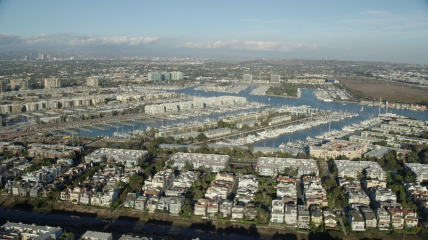 8K stock footage aerial video of waterfront apartment buildings overlooking marinas in Marina Del Rey, California Aerial Stock Footage | AX0161_053