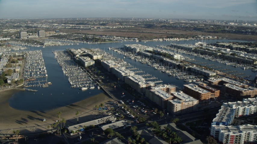 8K stock footage aerial video of waterfront apartment buildings overlooking marinas, Marina Del Rey, California Aerial Stock Footage | AX0161_054