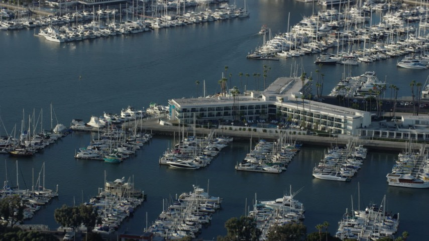 8K stock footage aerial video of Marina Del Rey Hotel and boats in the marina in Marina Del Rey, California Aerial Stock Footage | AX0161_058