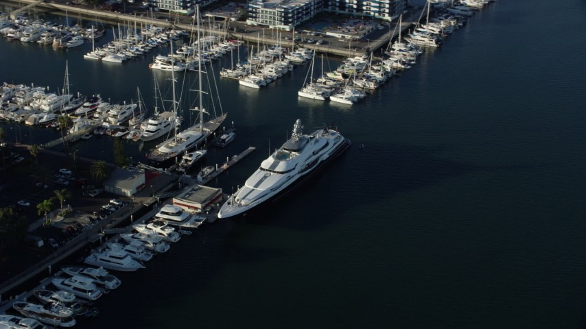 8K stock footage aerial video of a large yacht docked in Marina Del Rey, California Aerial Stock Footage | AX0161_059