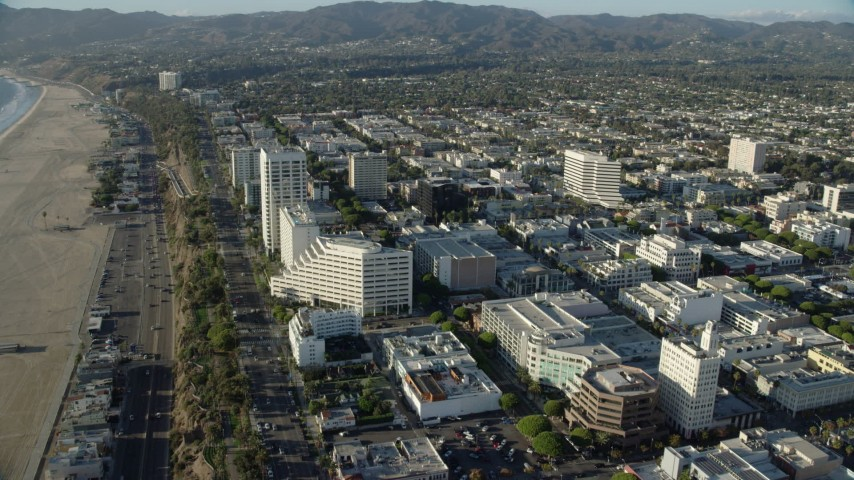 8K stock footage aerial video of office buildings by PCH and Ocean Avenue in Santa Monica, California Aerial Stock Footage | AX0161_073