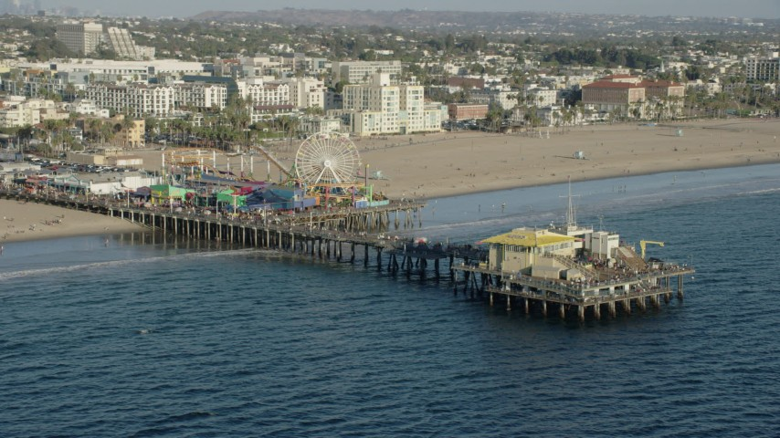 8K stock footage aerial video of tourists walking on Santa Monica Pier in Santa Monica, California Aerial Stock Footage | AX0161_081