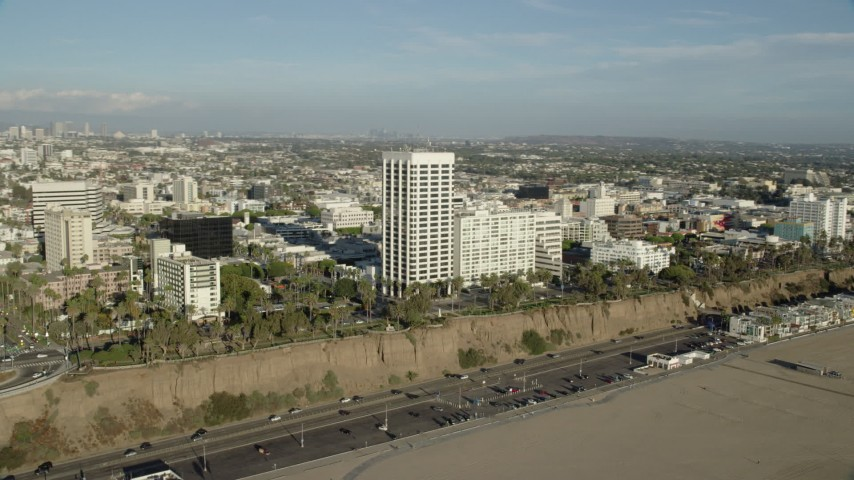 8K stock footage aerial video of office Buildings beside the Pacific Coast Highway in Santa Monica, California Aerial Stock Footage | AX0161_082
