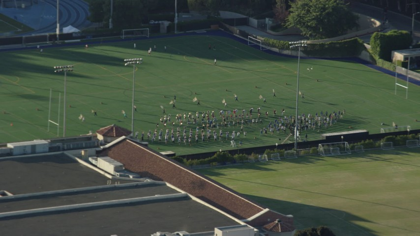 8K aerial video of the UCLA band practice on Intramural Field in Los Angeles, California Aerial Stock Footage | AX0161_092