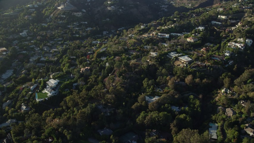 8K stock footage aerial video flying away from hillside mansions in Beverly Hills, California Aerial Stock Footage | AX0161_103