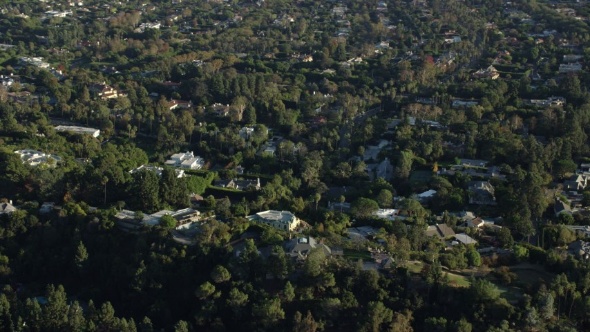 8K aerial video flying by mansions in upscale neighborhoods in Beverly Hills, California Aerial Stock Footage | AX0161_104