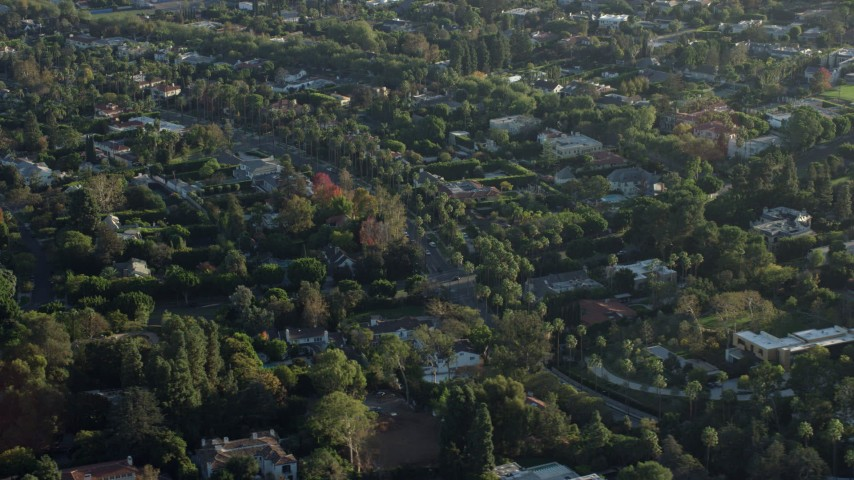 8K stock footage aerial video flying by mansions in upscale neighborhoods in Beverly Hills, California Aerial Stock Footage | AX0161_105
