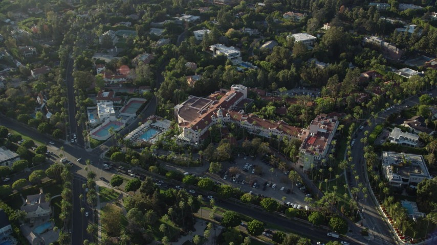 8K stock footage aerial video approaching the Beverly Hills Hotel in Beverly Hills, California Aerial Stock Footage | AX0161_109