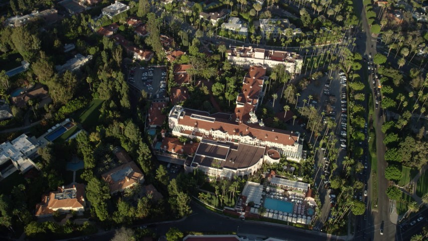 8K stock footage aerial video of a reverse view of the Beverly Hills Hotel in Beverly Hills, California Aerial Stock Footage | AX0161_110