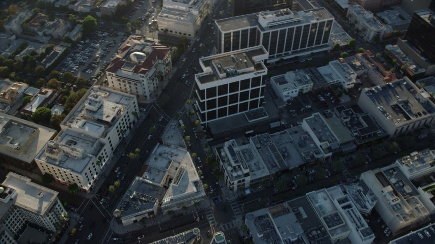 8K stock footage aerial video orbiting office buildings on Camden Drive to reveal shops on Rodeo Drive in Beverly Hills, California Aerial Stock Footage | AX0161_115