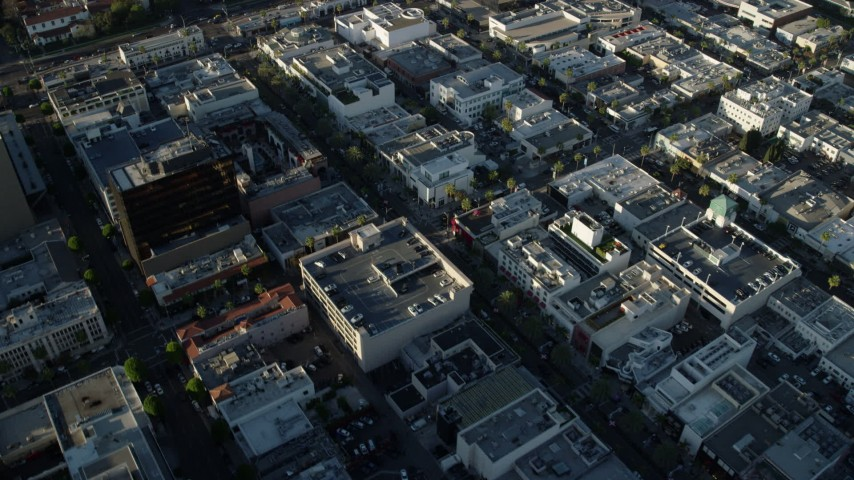 8K aerial video of shops on Rodeo Drive and nearby office buildings in Beverly Hills, California Aerial Stock Footage | AX0161_116