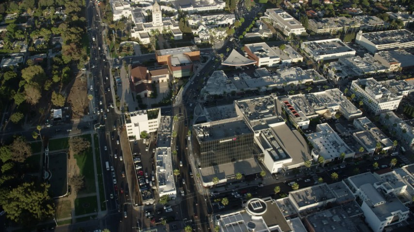 8K aerial video of shops and office building around Santa Monica Boulevard, reveal city hall in Beverly Hills, California Aerial Stock Footage | AX0161_117