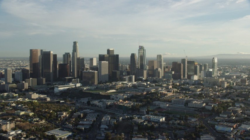 8K stock footage aerial video approaching the skyline in Downtown Los Angeles, California Aerial Stock Footage AX0162_002 | Axiom Images