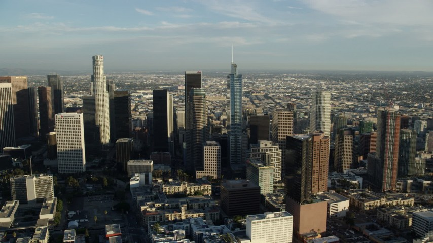 8K stock footage aerial video flying by the tall skyscrapers in Downtown Los Angeles, California Aerial Stock Footage | AX0162_004