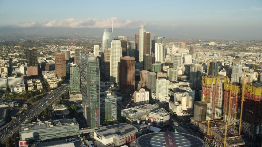 8K stock footage aerial video of tall skyscrapers, The Ritz-Carlton, and reveal Oceanwide Plaza in Downtown Los Angeles, California Aerial Stock Footage AX0162_006 | Axiom Images