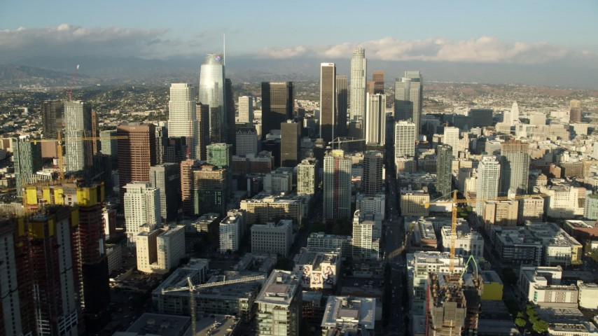 8K stock footage aerial video of Oceanwide Plaza and a view of tall skyscrapers in Downtown Los Angeles, California Aerial Stock Footage AX0162_007
