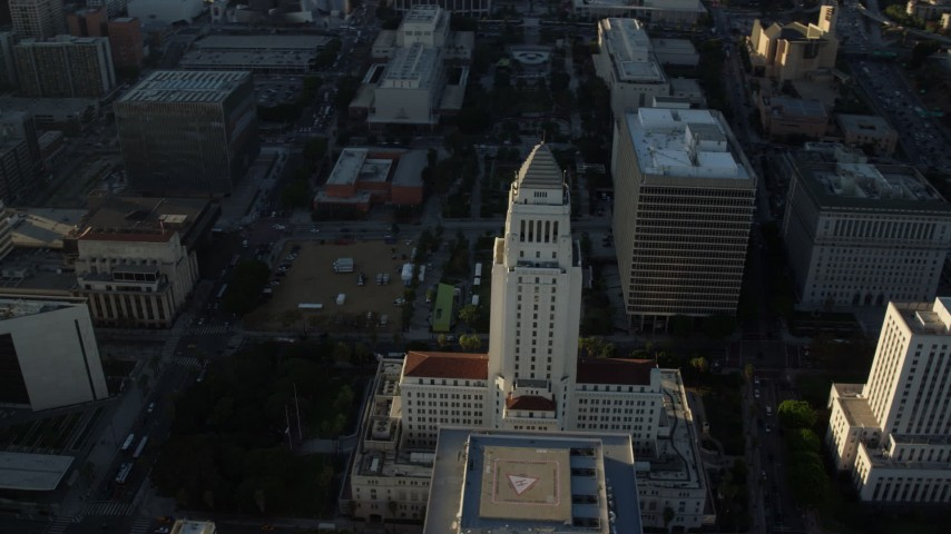 8K stock footage aerial video approaching and orbiting Los Angeles City Hall in Downtown Los Angeles, California Aerial Stock Footage | AX0162_010
