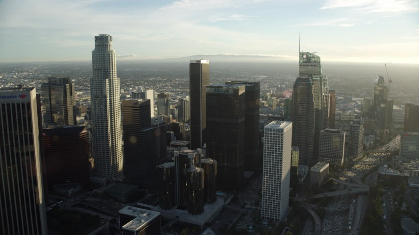 8K stock footage aerial video flying by skyscrapers around the Westin Bonaventure Hotel in Downtown Los Angeles, California Aerial Stock Footage | AX0162_012