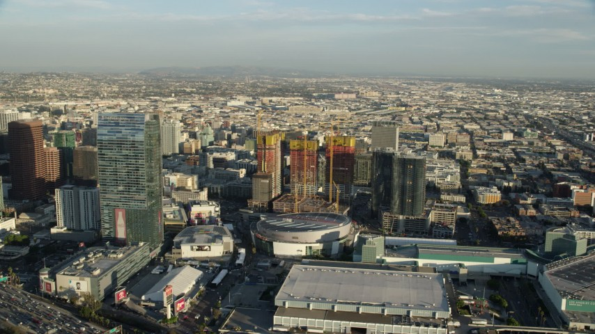 8K stock footage aerial video of the Ritz-Carlton Hotel, Staples Center, and Oceanwide Plaza in Downtown Los Angeles, California Aerial Stock Footage AX0162_015 | Axiom Images