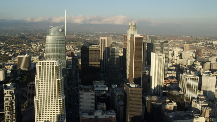8K stock footage aerial video flying between Wilshire Grand Center and Aon Center to approach US Bank Tower, Downtown Los Angeles, California Aerial Stock Footage | AX0162_019