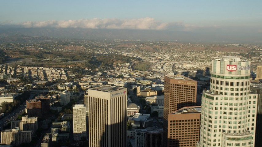 8K stock footage aerial video flying US Bank Tower and over Bank of America Center in Downtown Los Angeles, California Aerial Stock Footage | AX0162_020