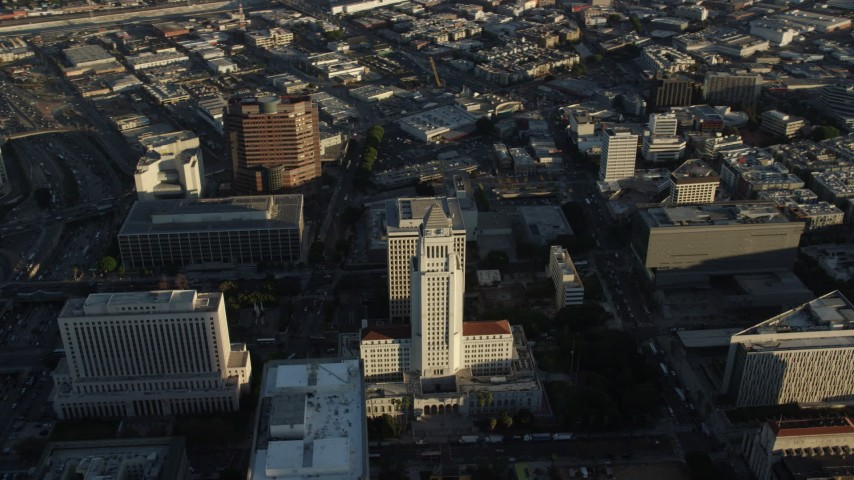 8K stock footage aerial video flying by Los Angeles City Hall in Downtown Los Angeles, California Aerial Stock Footage | AX0162_021