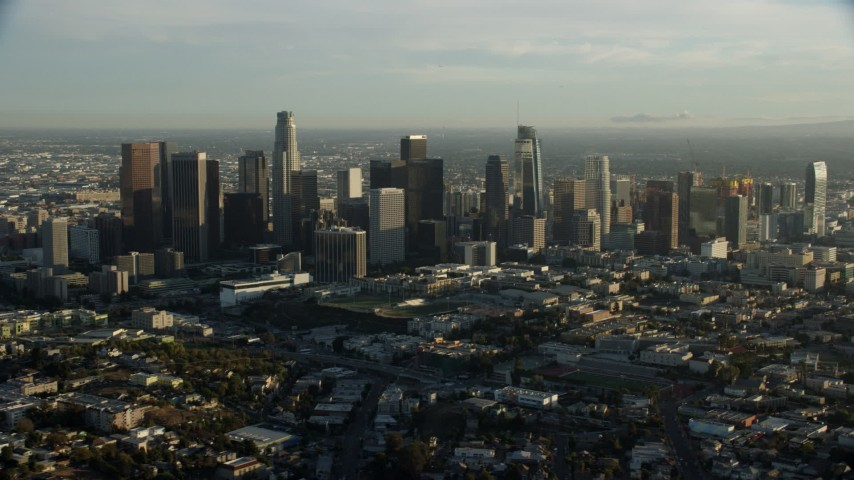 8K stock footage aerial video of Downtown skyscrapers on a hazy day in Downtown Los Angeles, California Aerial Stock Footage | AX0162_023